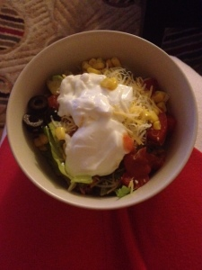 My burrito bowl, topped with a heaping spoonful (or two) of plain chobani.