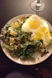 Two eggs on a salad with lentils, cucumbers, peppers, goat cheese and tossed in salsa and plain chobani