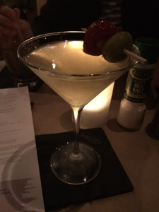 A dirty martini with blue cheese stuffed olives AND a cherry pepper!