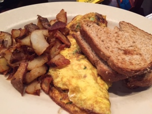 Brunch at Maggie Mcfly's.. My veggie and goat cheese omelet... Yummm